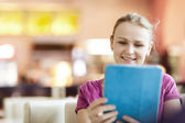 Young happy woman in cafe with tablet PC — Foto Stock