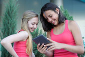 Two teen girls with tablet PC — Stock Photo