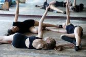 Three ballet dancers on the floor during rehearsal — Stock Photo