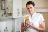 Cosmetician holding box with cosmetic — Stock fotografie