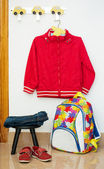 Children's clothes, backpack, shoes — Stock Photo