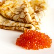 Pancakes with red caviar - Stock Photo