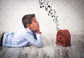 Boy listening to retro radio — Stock Photo