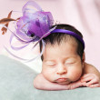 Little cute baby girl on a pink background — Stockfoto