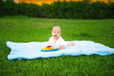 Cheerful cute kid on the nature — Stock Photo