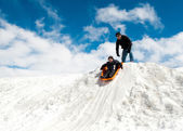 Boy and dad sledding in winter — Stock Photo
