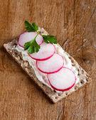 Radishes on crispbread — Stock Photo