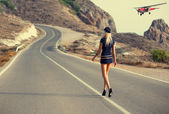 Beautiful girl walking along — Stock Photo