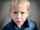 Portrait of the offended little boy — Stock Photo