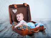 Little boy in the old days a suitcase — Stock Photo