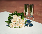 Bridal bouquet with beautiful glasses — Stock Photo