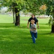 Young boy playing football with his father — Stock Photo #13102493