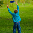 Little boy playing frisbee — Stock Photo