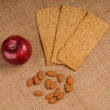 Red apple with crispbread and almonds — Stockfoto
