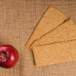 Red apple with crispbread — Stock Photo