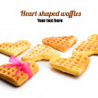 Heart shaped waffles with pink ribbon — Stock Photo