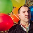 Man with balloons — Stock Photo