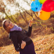 Girl with ballons — Stock Photo #21009011