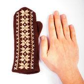Brown mitten an hand — Stock Photo