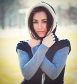 Young thoughtful woman in hood — Stock Photo