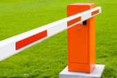 Red and white closed barrier — Stock Photo