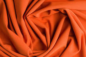 Spiral folds on red cloth — Stock Photo