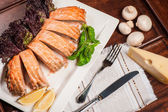 Salmon stuffed with cheese and mushrooms — Stock Photo