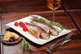 Grilled fish with white wine — Stock Photo