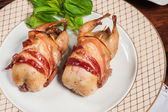 Two fried quails with bacon — Stock Photo