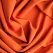 Stock Photo: Spiral folds on red cloth