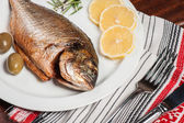 Fried fish with white wine — Stock Photo