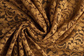 Spiral folds on Yellow lace fabric — Stock Photo