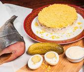 Traditional russian salad named mimosa — Stock Photo