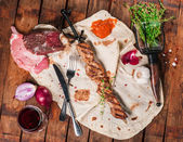Grilled meat with spices — Stock Photo