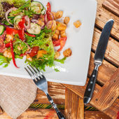 Salad served with fried meat — Stock Photo