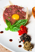 Classic tartare with fresh basil — Stock Photo