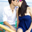 Couple in love kissing on a boat — Stock Photo