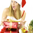 Happy female Santa Claus preparing packages — Stock Photo