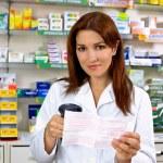 Happy pharmacist at work — Stock Photo