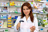 Happy pharmacist at work — Stock Photo