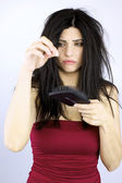 Sad woman holding fallen hair healthcare problems — Stock Photo