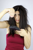 Woman scared about loosing lots of hair — Stock Photo