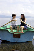 Happy couple in love on boat in vacation — Stock Photo
