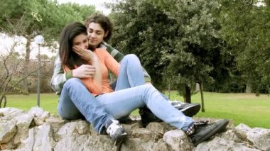 Happy couple in love hugging in park — Stock Video