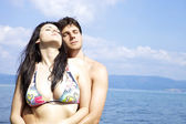 Beautiful woman hugged by handsome man in the water — Stockfoto