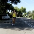 Woman jogging on street — Stok video