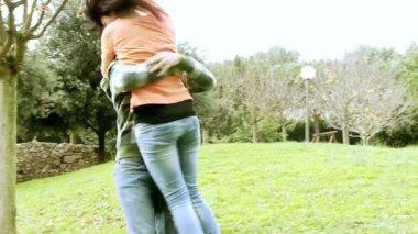 Boyfriend holding girlfriend in love running — Stock Video