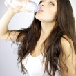Happy woman drinking water looking — Stock Photo