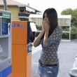 Woman amazed by price of gas at gasoline station — Stock Photo #27462673