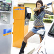 Womready to destroy gas station — Stock Photo #27462677